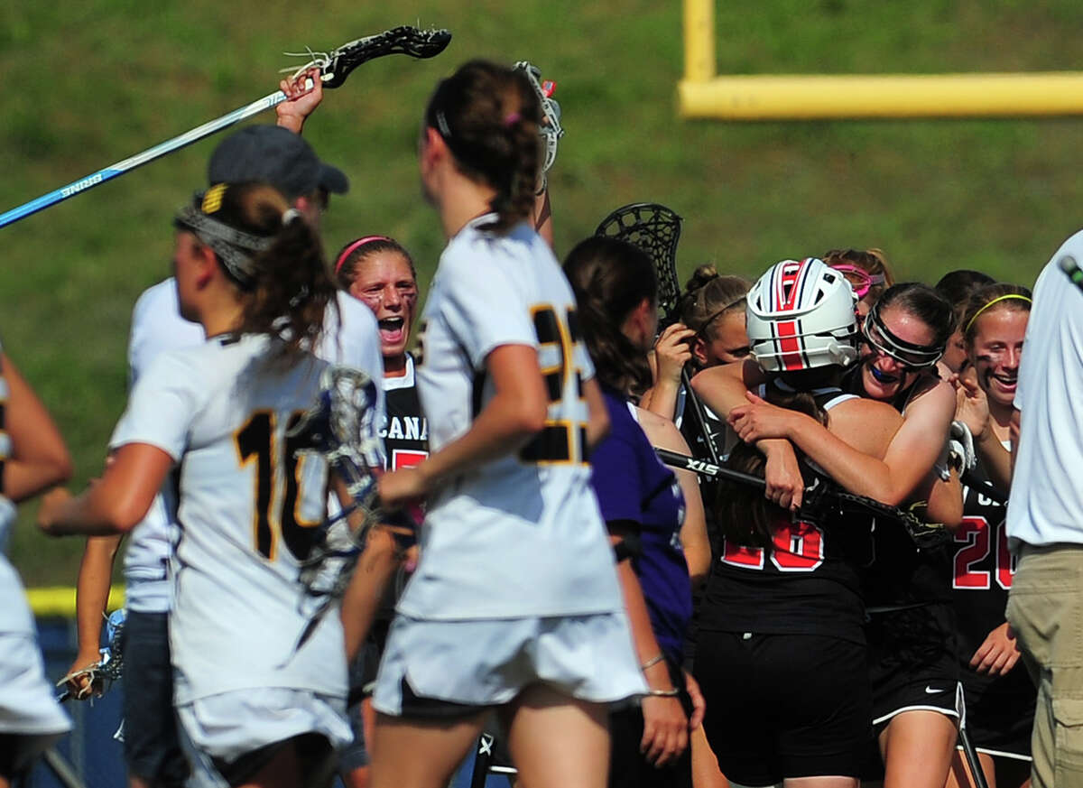 New Canaan celebrates after defeating Daniel Hand, during Class M lacrosse championship action at Bunnell High School in Stratford, Conn., on Saturday June 13, 2015.