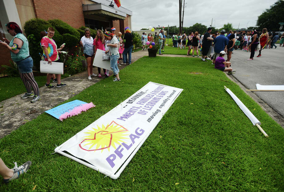 A banner for PFLAG -- Parents, Families and Friends of Lesbians and Gays -- sits on the grass next to Broadway Street on Saturday. The second annual Beaumont Pride walk and festival was held Saturday in downtown Beaumont. Participants walked down Broadway to Crockett Street, where more than two dozen vendors were arranged in the parking area. Photo taken Saturday 6/13/15 Jake Daniels/The Enterprise Photo: Jake Daniels / ©2015 The Beaumont Enterprise/Jake Daniels