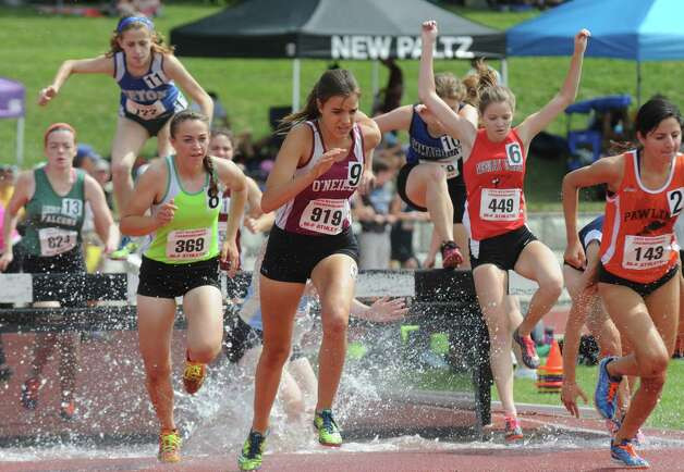 Girls compete in the 2,000 meter steeplechase during the New York State High School Track and Field Championships at UAlbany on Saturday June 13, 2015 in Albany , N.Y.  (Michael P. Farrell/Times Union) Photo: Michael P. Farrell / 10032256B