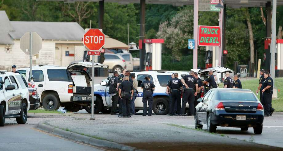 Police block the intersection of Dowdy Ferry Rd and Interstate 45 during a stand off with a gunman barricaded inside a van, Saturday, June 13, 2015, in Hutchins, Texas. The gunman allegedly attacked Dallas Police Headquarters. (AP Photo/Brandon Wade) Photo: Brandon Wade, FRE / FR168019 AP