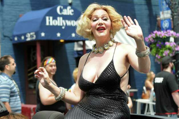 Grand Marshal, Calpernia Addams, waves and blows kisses to her adoring fans during the Capital PRIDE Parade on Saturday, June 13, 2015, in Albany, N.Y. (Cindy Schultz / Times Union) Photo: Cindy Schultz / 00032232A