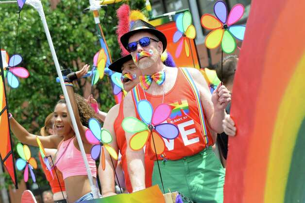 Parade participants ride on the Pride in Motion float during the Capital PRIDE Parade on Saturday, June 13, 2015, in Albany, N.Y. (Cindy Schultz / Times Union) Photo: Cindy Schultz / 00032232A