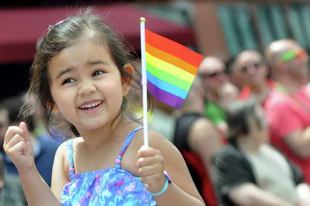 Zoey Magan, 4, of Albany waves her flag during the Capital PRIDE Parade on Saturday, June 13, 2015, in Albany, N.Y. (Cindy Schultz / Times Union) Photo: Cindy Schultz / 00032232A