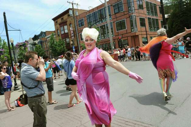 Drag queen Frieda Munchon, center, poses for a photo during the Capital PRIDE Parade on Saturday, June 13, 2015, in Albany, N.Y. (Cindy Schultz / Times Union) Photo: Cindy Schultz / 00032232A