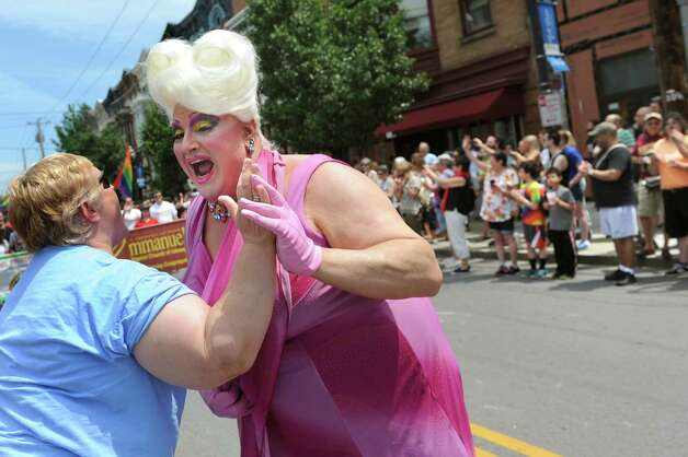 Drag queen Frieda Munchon, center, greets one of her adoring fans during the Capital PRIDE Parade on Saturday, June 13, 2015, in Albany, N.Y. (Cindy Schultz / Times Union) Photo: Cindy Schultz / 00032232A