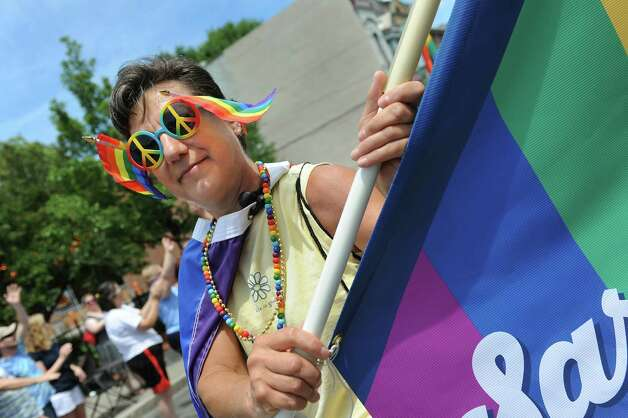 Nancy Wudak of Saratoga Springs marches with her group in the Capital PRIDE Parade on Saturday, June 13, 2015, in Albany, N.Y. (Cindy Schultz / Times Union) Photo: Cindy Schultz / 00032232A