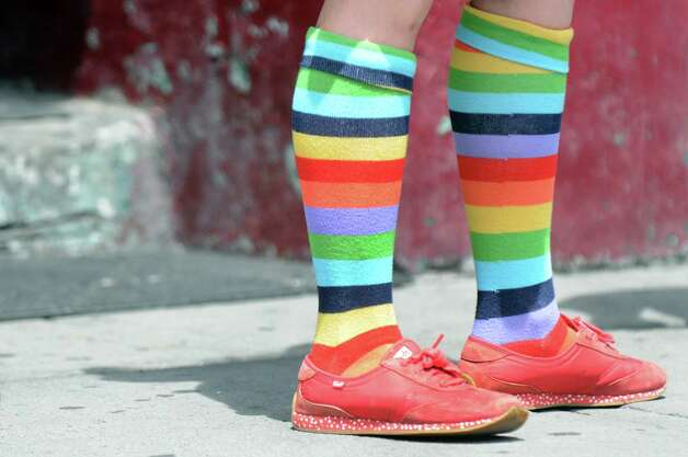 Robyn Filkins of Selkirk wears her colorful socks during the Capital PRIDE Parade on Saturday, June 13, 2015, in Albany, N.Y. (Cindy Schultz / Times Union) Photo: Cindy Schultz / 00032232A