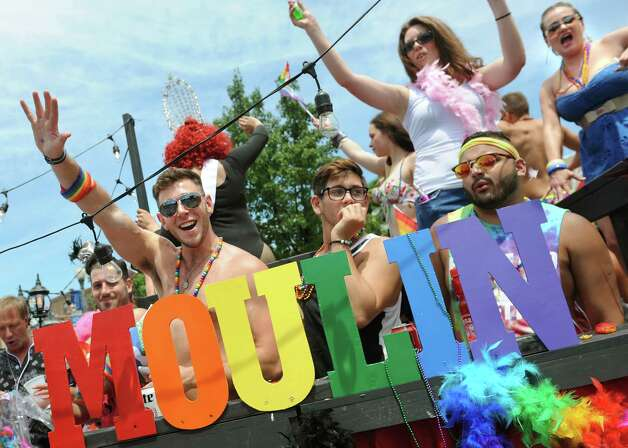Parade participants wave from their float during the Capital PRIDE Parade on Saturday, June 13, 2015, in Albany, N.Y. (Cindy Schultz / Times Union) Photo: Cindy Schultz / 00032232A