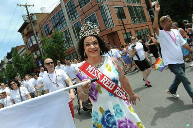 Madam, also known as Adam Brady, center, wears her tiara and banner proudly during the Capital PRIDE Parade on Saturday, June 13, 2015, in Albany, N.Y. (Cindy Schultz / Times Union) Photo: Cindy Schultz / 00032232A