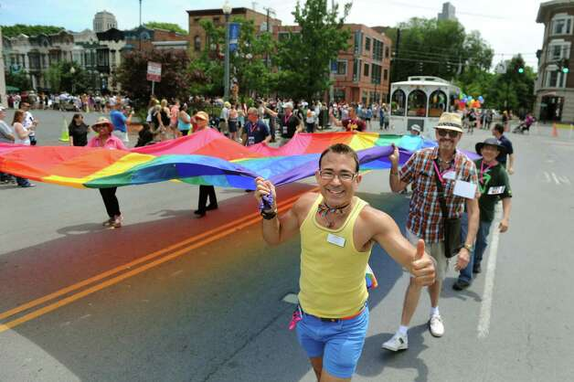 Parade participants carry the rainbow flag during the Capital PRIDE Parade on Saturday, June 13, 2015, in Albany, N.Y. (Cindy Schultz / Times Union) Photo: Cindy Schultz / 00032232A