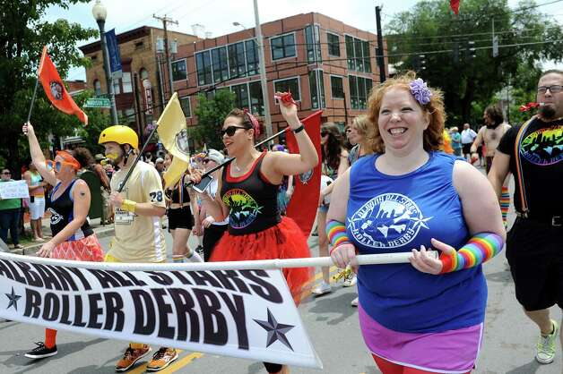 Albany All Star Roller Derby players take part in the Capital PRIDE Parade on Saturday, June 13, 2015, in Albany, N.Y. (Cindy Schultz / Times Union) Photo: Cindy Schultz / 00032232A