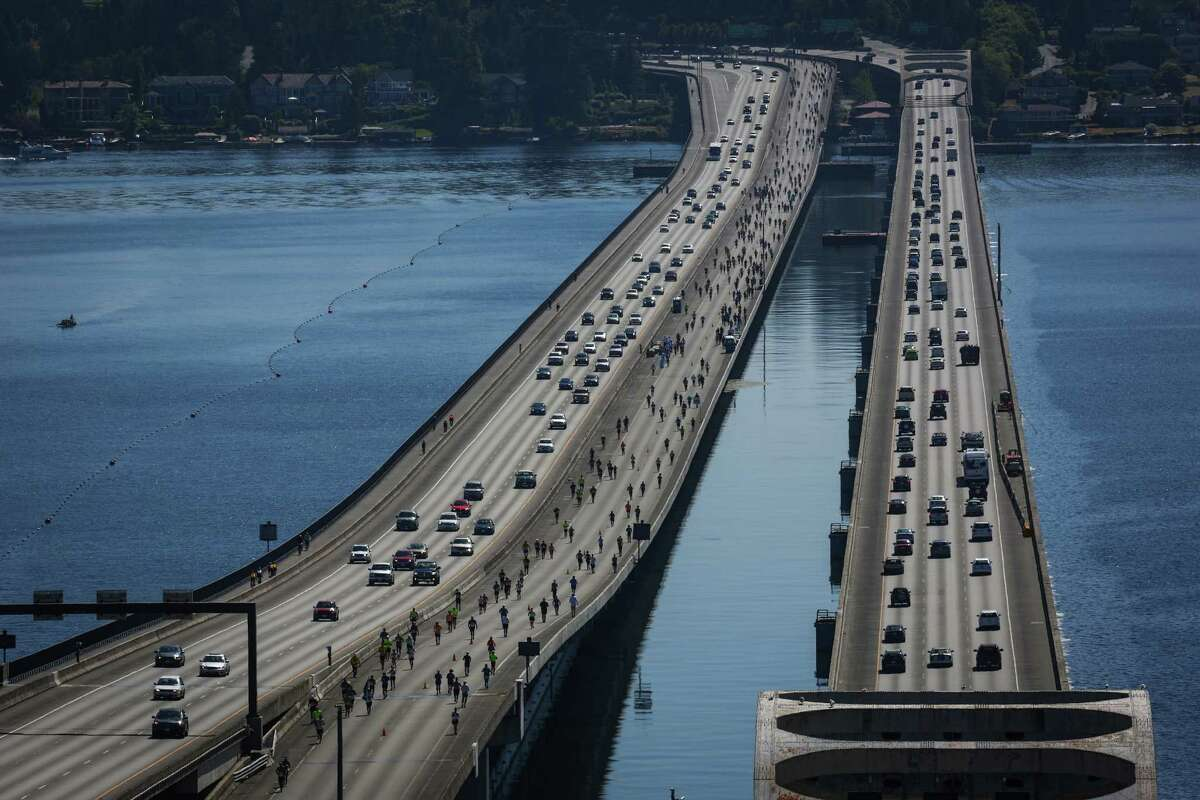 Runners take up the middle lanes of Interstate 90 over Lake Washington. Runners had the option of a full marathon, a half marathon or an 8K and all were serenaded by a series of bands along the course.