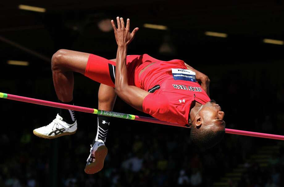 Texas Tech's JaCorian Duffield clears the bar en route to winning the high jump event during the NCAA track and field championships in Eugene, Ore., on June 12, 2015. Photo: Ryan Kang /Associated Press / FR171219 AP