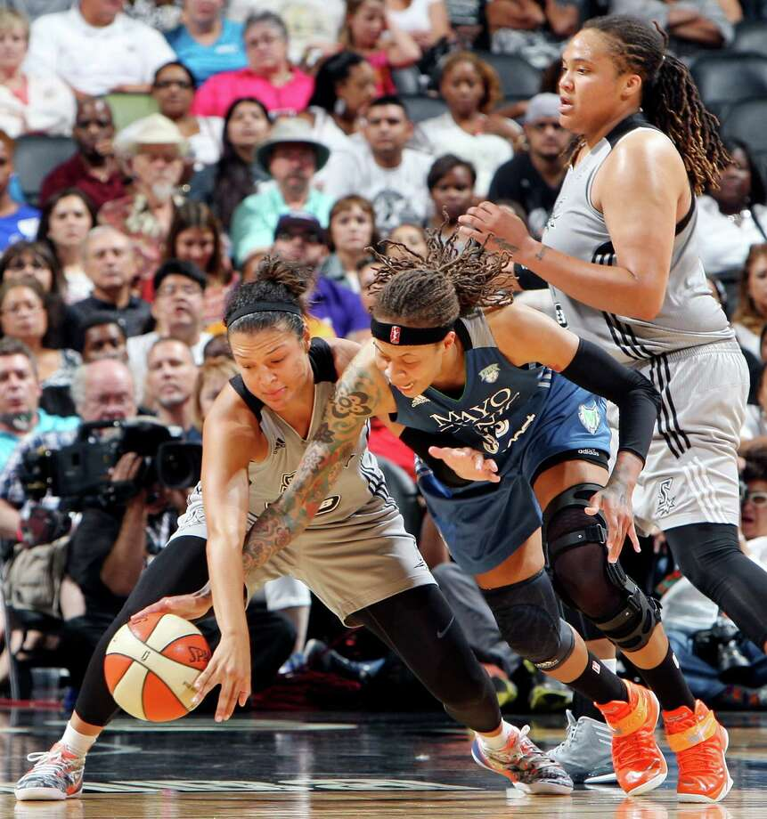 San Antonio Stars' Kayla McBride and  Minnesota Lynx's Seimone Augustus chase after a loose ball as  San Antonio Stars' Danielle Adams looks on during second half action Saturday Aug. 23, 2014 at the AT&T Center. The Lynx won 94-89. Photo: Edward A. Ornelas, Staff / San Antonio Express-News / © 2014 San Antonio Express-News