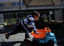 Tim Li plays during a preschool session at Corvallis Elementary School in San Lorenzo. California lawmakers propose expanding subsidized preschool slots far beyond Gov. Jerry Brown's proposal.