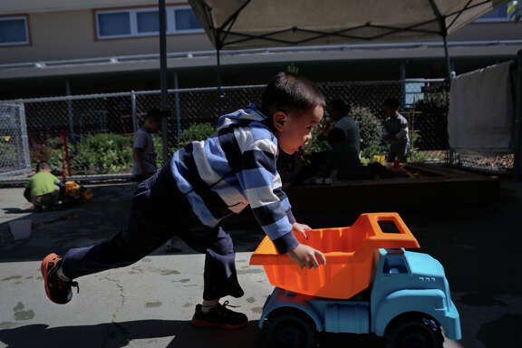 Tim Li plays during a preschool session at Corvallis Elementary School in San Lorenzo. California lawmakers propose expanding subsidized preschool slots far beyond Gov. Jerry Brown's proposal.