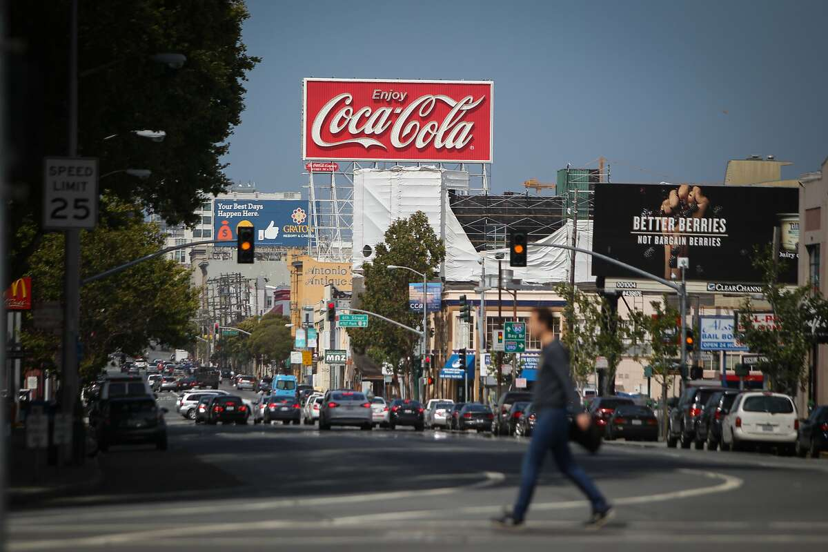 A giant Coca-Cola billboard along Interstate 80 near the Bay Bridge in San Francisco, California, is seen on Saturday, June 13, 2015. The City of San Francisco recently passed a law requiring that soda advertisements carry a warning label. Exempted are the pictured sign and the Giants' world-famous Coke bottle slide at AT&T Park.
