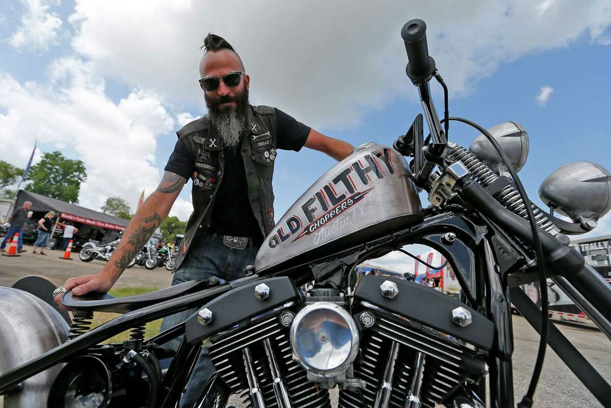 """Custom bike builder Abraham Nasser stands by his hand-built bike that he entered in the Ride in Bike Show competition at the 20th Annual Republic of Texas Biker Rally in Austin on Saturday, June 13, 2015. Nasser has taken the top prize for the past four years. Organizers said the event attracts about 38-45,000 visitors a year which features motorcycles of all kinds, concerts and vendors catering to bikers. Though the event has changed from past years by adding events to attract bikers, little else has changed. """"At the heart of it, (the event) is about bikers,"""" said Matt Ceniceros of Media Relations. The event concludes on Sunday. (Kin Man Hui/San Antonio Express-News)"""