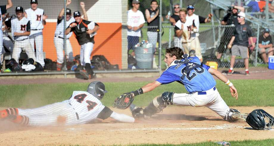 Saratoga catcher #20 Brendan Coffey can't tag Mamaroneck's #44 Andrew Gross, left, in time during the Class AA championship game Saturday June 13, 2015 in Endicott, NY.   (John Carl D'Annibale / Times Union) Photo: John Carl D'Annibale / 00032266A