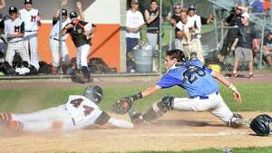 Saratoga catcher #20 Brendan Coffey can't tag Mamaroneck's #44 Andrew Gross, left, in time during the Class AA championship game Saturday June 13, 2015 in Endicott, NY.   (John Carl D'Annibale / Times Union)