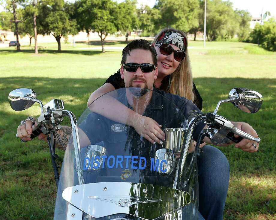 William and Morgan English with their Yamaha motorcycle in Brenham on Tuesday. They spent days in jail after shootout at Twin Peaks in Waco.