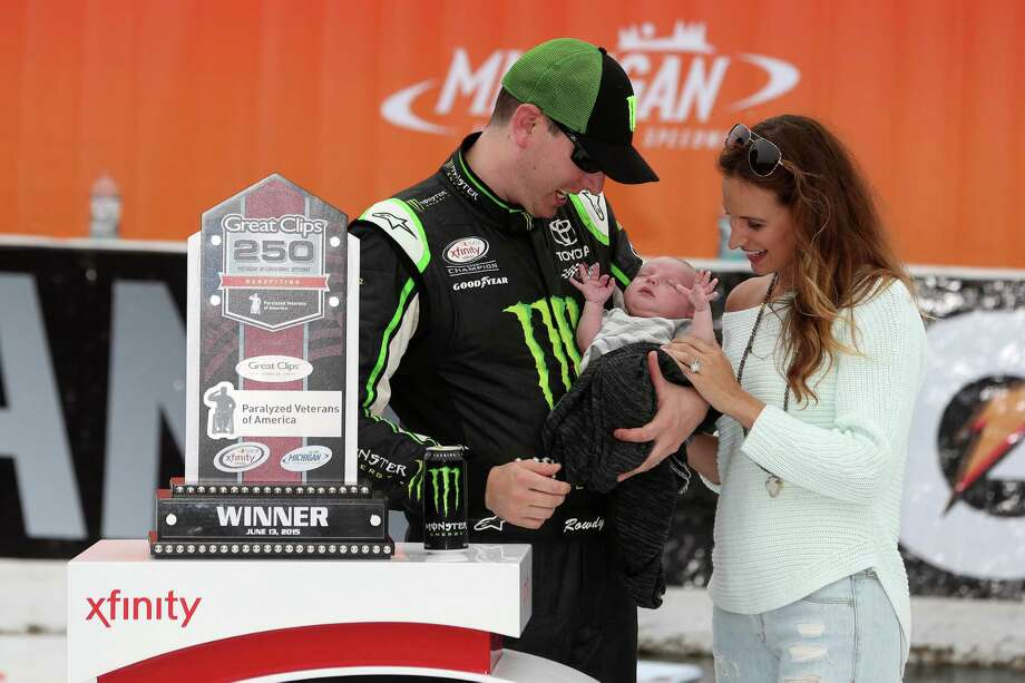BROOKLYN, MI - JUNE 13:  Kyle Busch, driver of the #54 Monster Energy Toyota, holds son Brexton Locke with wife Samantha after winning the NASCAR XFINITY Series Great Clips 250 Benefiting Paralyzed Veterans of America at Michigan International Speedway on June 13, 2015 in Brooklyn, Michigan.  (Photo by Brian Lawdermilk/Getty Images) Photo: Brian Lawdermilk, Stringer / Getty Images / 2015 Getty Images