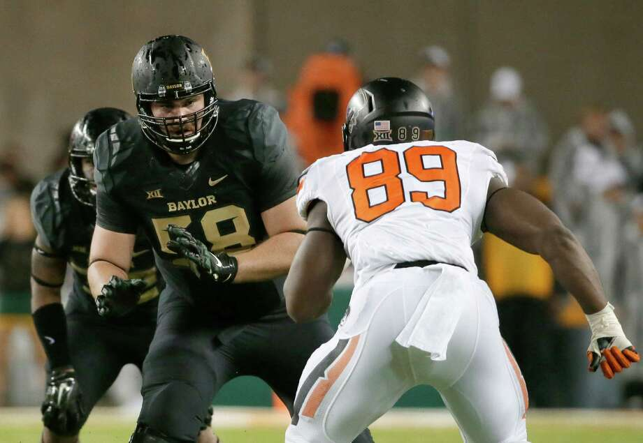 FILE - In this Nov. 22, 2014, file photo, Baylor offensive tackle Spencer Drango (58) defends against a rush by Oklahoma State defensive end Sam Wren (89) during an NCAA college football game in Waco, Texas. Fourth-ranked Baylor had a league-high five first-team picks, including Spencer Drango as a unanimous pick on offensive line. (AP Photo/Tony Gutierrez) Photo: Tony Gutierrez, STF / AP
