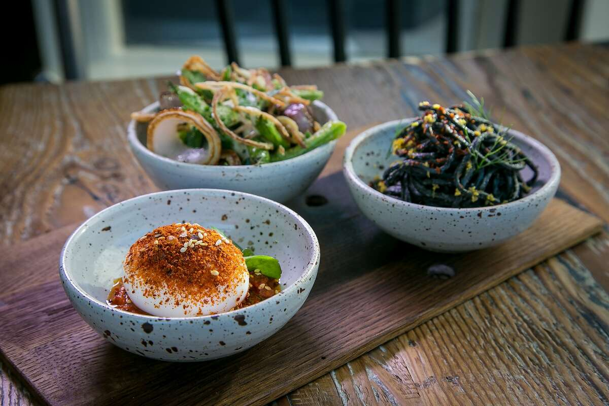 The Deviled Egg, the chilled Squid Ink Noodles and the blistered Romano Beans at Octavia in San Francisco, Calif., are seen on June 12th, 2015.