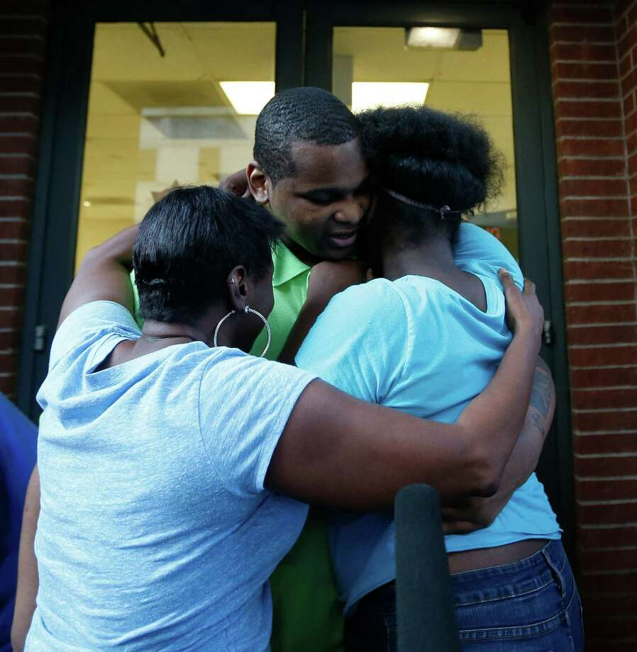 Alfred Brown walks out of the Harris County Jail and into the arms of his sister Connie Brown, left, and daughter Kierra Brown, 15, on Monday.  Photo: Karen Warren, Staff / © 2015 Houston Chronicle