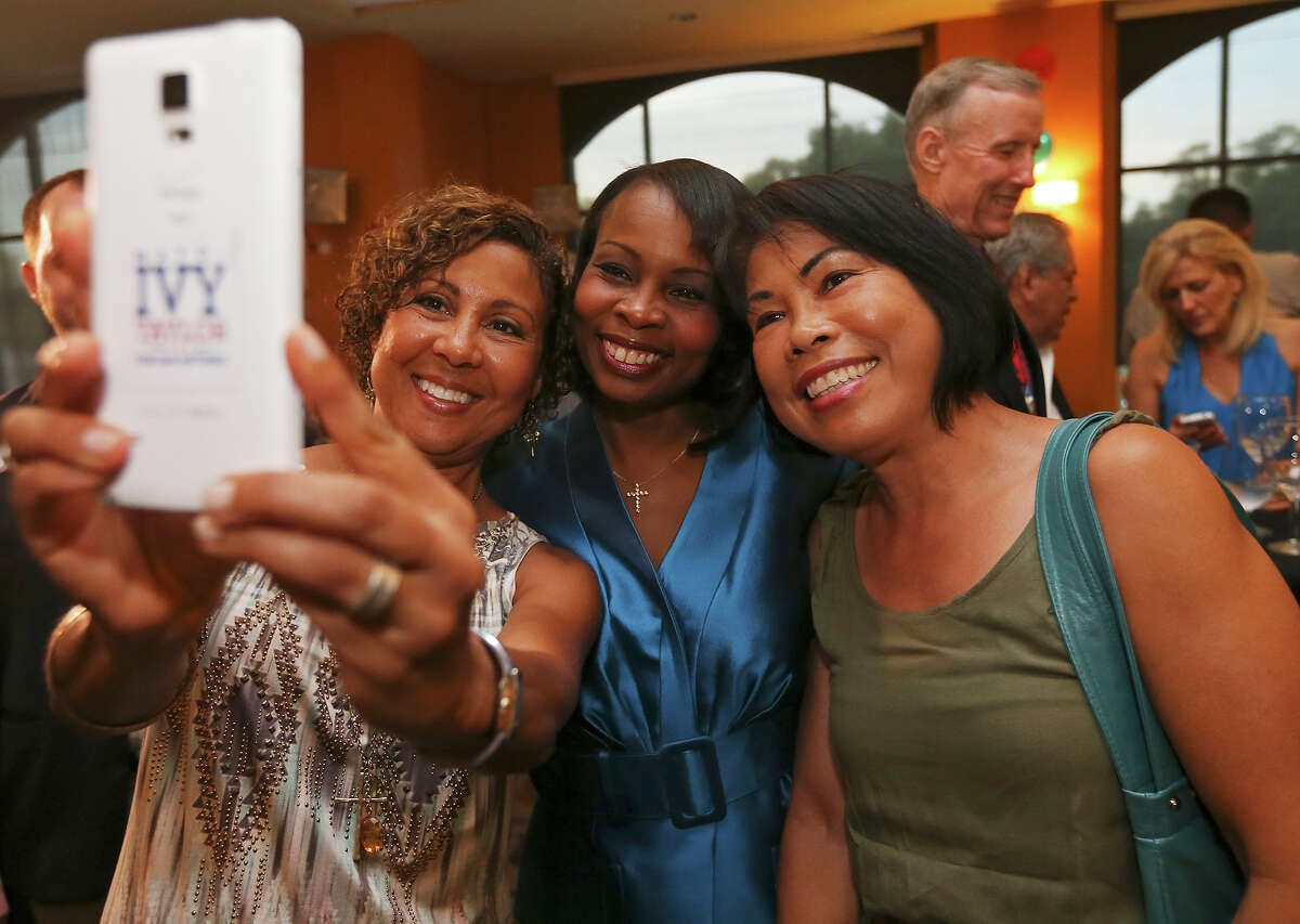 Mayoral candidate Mayor Ivy Taylor (center) poses for a selfie with supporters Jazzy Ratliff (left) and Adnil Buse at a watch party held Saturday June 13, 2015 at the Wyndam Garden San Antonio Riverwalk Museum Reach Hotel.