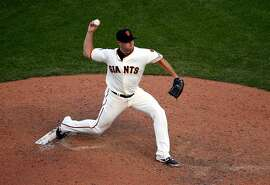 SAN FRANCISCO, CA - JUNE 13:  Mike Broadway #57 of the San Francisco Giants pitches against the Arizona Diamondbacks at AT&T Park on June 13, 2015 in San Francisco, California.  (Photo by Ezra Shaw/Getty Images)