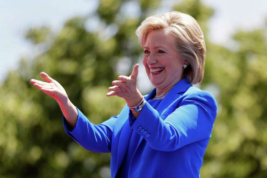 Democratic presidential candidate, former Secretary of State Hillary Rodham Clinton gestures to supporters as she arrives to speak Saturday, June 13, 2015, on Roosevelt Island in New York. (AP Photo/Julio Cortez) Photo: Julio Cortez, STF / AP