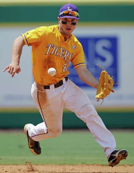 Notice that No. 8 on LSU shortstop Alex Bregman's jersey? It's reserved for the Tigers' best player and has been donned by Bregman the past two seasons. Photo: Gerald Herbert, STF / AP