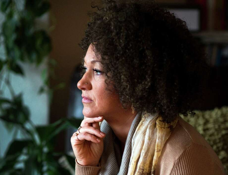 FILE- In this March 2, 2015 file photo, Rachel Dolezal, president of the Spokane chapter of the NAACP, poses for a photo in her Spokane, Wash. home. Dolezal is facing questions about whether she lied about her racial identity, with her family saying she is white but has portrayed herself as black, Friday, June 12, 2015. (Colin Mulvany/The Spokesman-Review via AP, File) COEUR D'ALENE PRESS OUT Photo: Colin Mulvany, MBI / THE SPOKESMAN-REVIEW