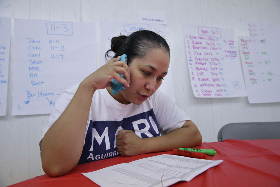 Mari Aguirre-Rodriguez, runoff candidate against Cris Medina in District 7,  wraps up her last minute campaign efforts by determining which streets to canvas in her area during the last hours of voting  on June 13, 2015. Photo: Tom Reel / San Antonio Express-News