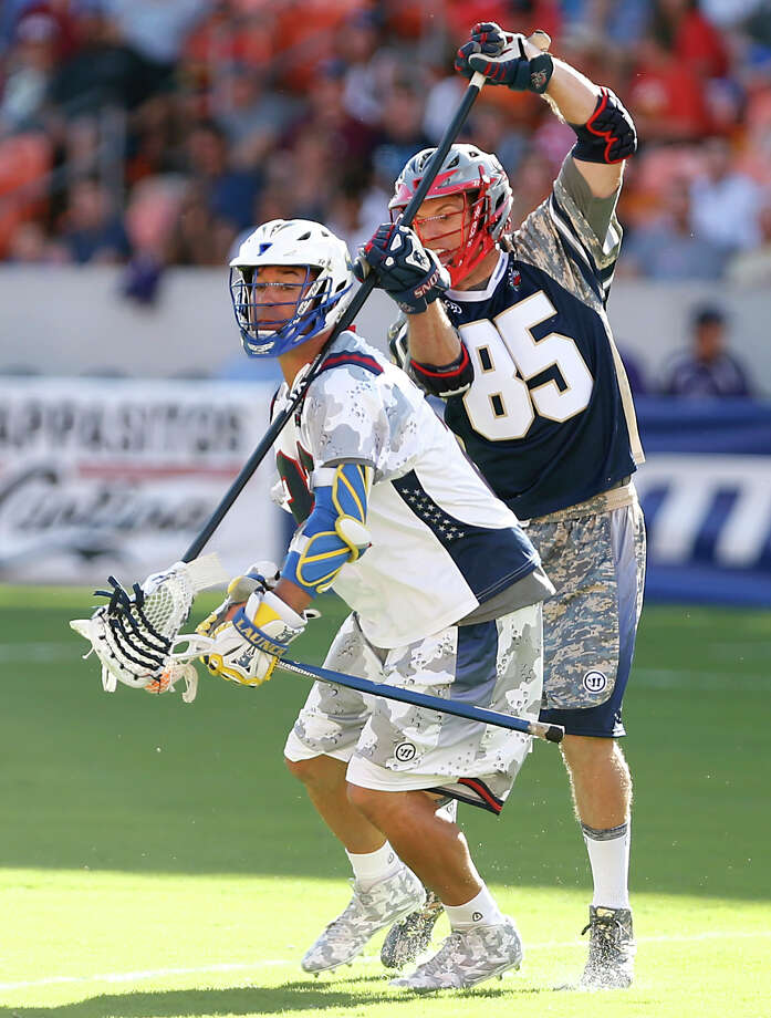 The MLL Cowboys' Casey Powell left, and the MLL Gladiators' Mitch Belisle right, during first quarter of the 2015 Major League Lacrosse All-Star Game at BBVA Compass Stadium Saturday, June 13, 2015, in Houston. Photo: James Nielsen, Houston Chronicle / © 2015  Houston Chronicle