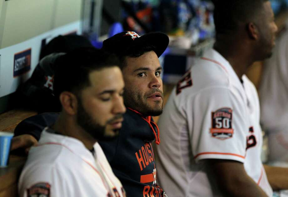 Houston Astros second baseman Jose Altuve (27), center,  out with an injury, watches from the dug out with Houston Astros shortstop Marwin Gonzalez (9) and Houston Astros starting pitcher Roberto Hernandez (56) in a baseball game against the Seattle Mariners played at Minute Maid Park Saturday, June 13, 2015, in Houston. ( Gary Coronado / Houston Chronicle ) Photo: Gary Coronado, Staff / © 2015 Houston Chronicle