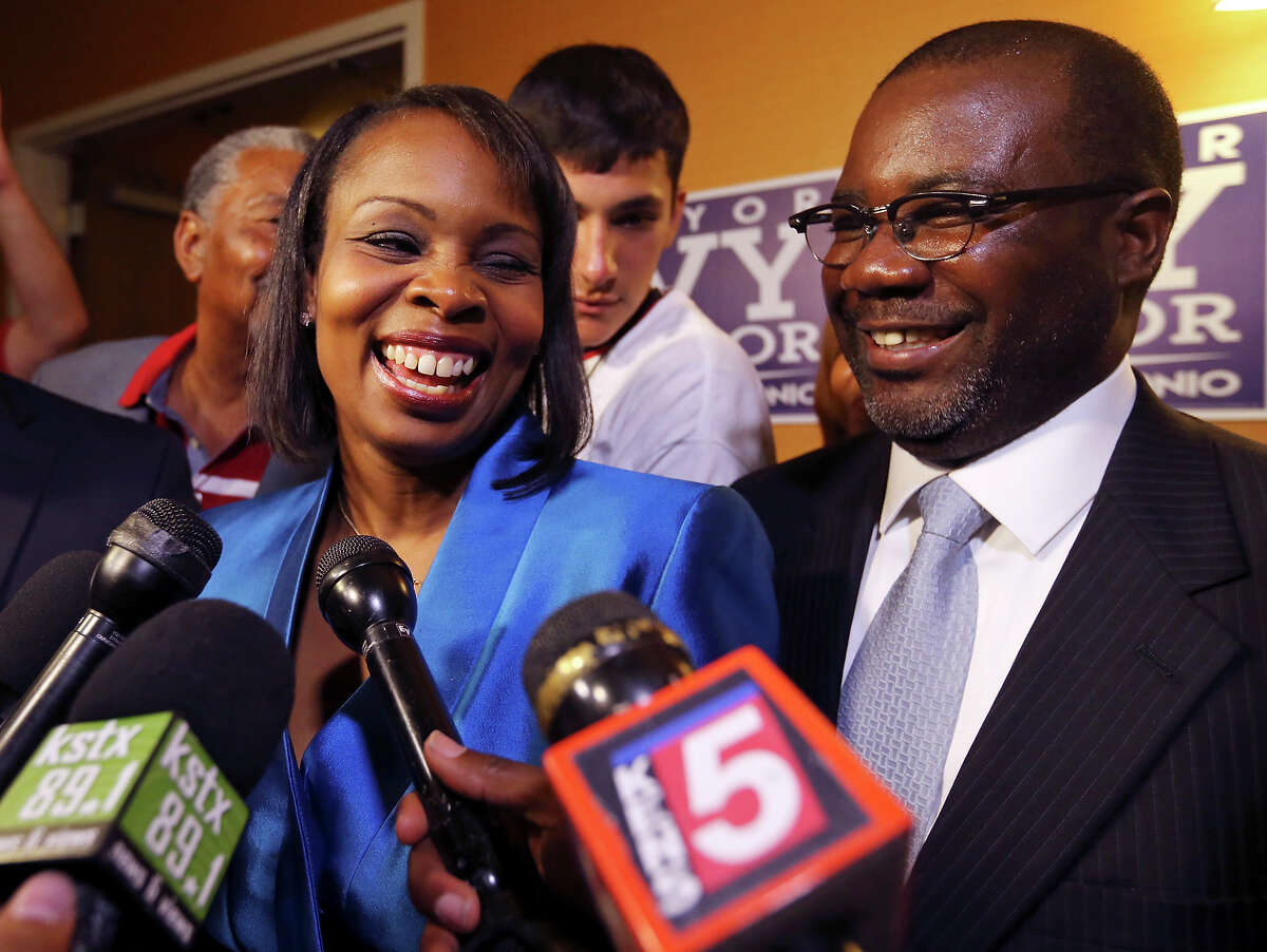 Mayor Ivy Taylor (left) answers questions from the media as her husband Rodney Taylor looks on at a watch party held Saturday June 13, 2015 at the Wyndam Garden San Antonio Riverwalk Museum Reach Hotel.