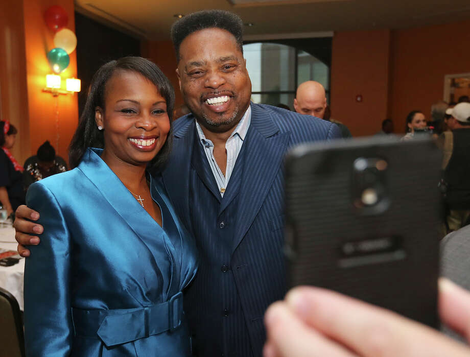 Mayoral candidate Mayor Ivy Taylor (left) poses for a photo with The Alternative-Christians United Ministries, Pastor Ernest Hollins at a watch party held Saturday June 13, 2015 at the Wyndam Garden San Antonio Riverwalk Museum Reach Hotel. Photo: Edward A. Ornelas, Staff / San Antonio Express-News / © 2015 San Antonio Express-News