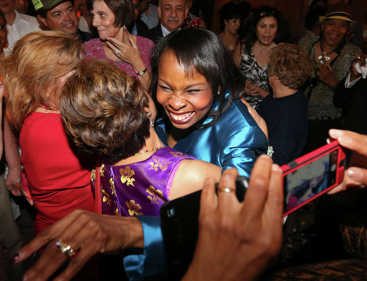 Mayor Ivy Taylor celebrates with supporters at a watch party on election night. Readers comment on her victory.