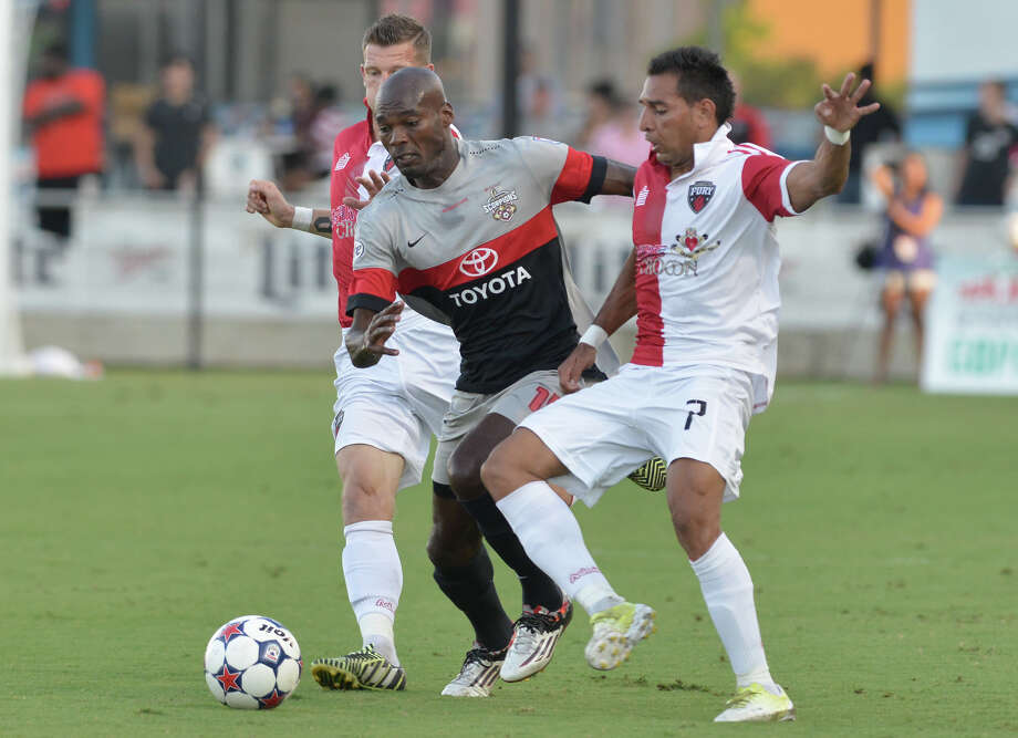Omar Cummings (middle) and the Scorpions tied Ottawa 0-0 on Saturday at Toyota Field, but the Scorpions head into the 20-game fall season on an upswing after a slow start to the spring season. In their last six games, they have notched three shutouts. Photo: Robin Jerstad /For The Express-News