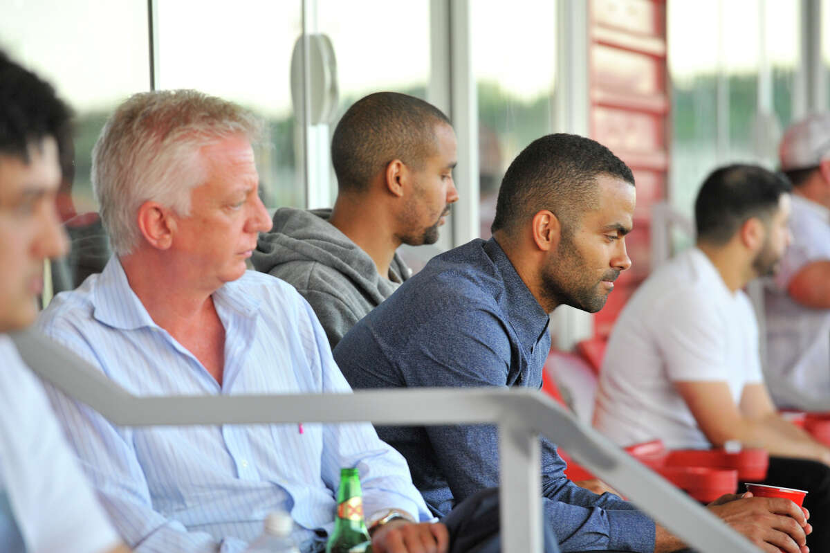 Scorpions owner Gordon Hartman sits with Spurs star Tony Parker at Toyota Field.
