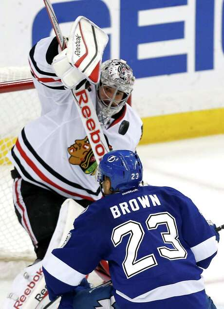 Blackhawks goalie Corey Crawford stops the Lightning's J.T. Brown for one of Crawford's 31 saves. Photo: Mike Carlson, Stringer / 2015 Getty Images