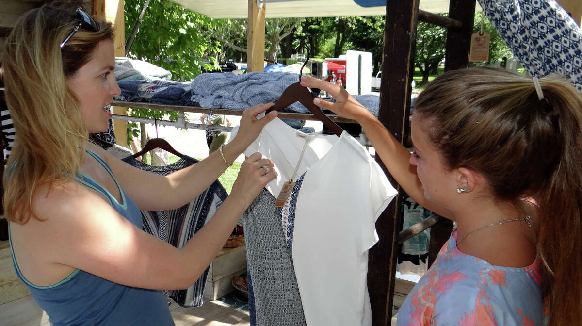 Pop Shop Market co-founder Andrea Espach consults on an outfit with Tai Truglio of Faherty Brand at the weekend-long Pop Shop Market on Town Hall Green.