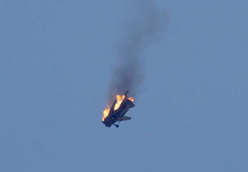 An aircraft belonging to Syrian regime forces bursts into flames after it was hit by Syrian oppositions linked to Southern Front when it was launching airstrikes on opposition-controlled areas in Daraa, Syria on June 11, 2015. (Photo by Ibrahim Hariri/Anadolu Agency/Getty Images)Latest from AP: 2 bombs hit central Syria city of Homs, wounding at least 32