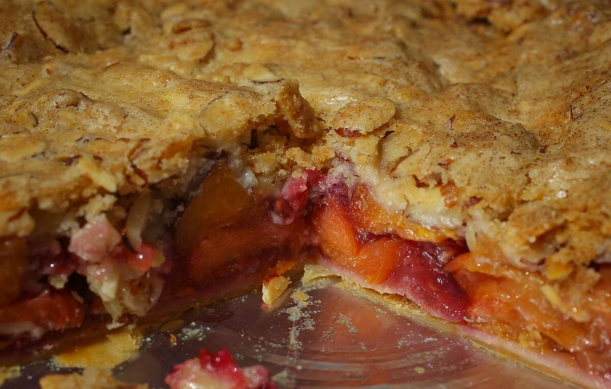 A peach raspberry pie with almond streusel topping is seen at the Three Babes Bakeshop Stand at the Ferry Plaza Farmers Market in San Francisco, California, on Saturday, June 13, 2015.