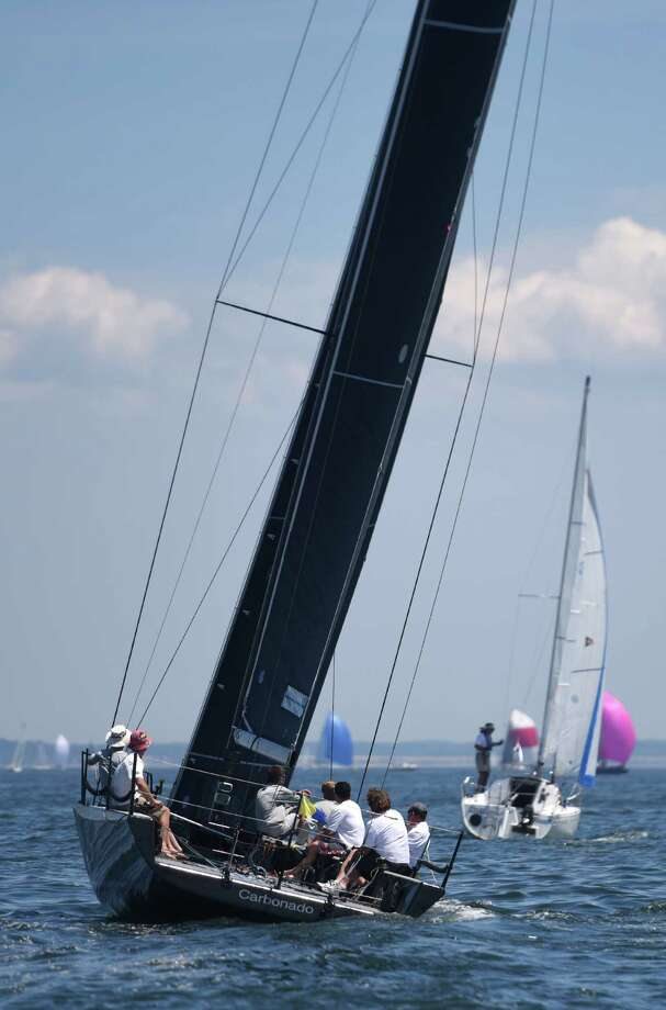 The crew of Carbonado, owned by Riverside's John Barry, cruises with the wind while competing in the 30th annual Mayor's Cup boat race in the Long Island Sound off the shore of Stamford, Conn. Sunday, June 14, 2015.  Over 40 boats competed in the race separated into six categories for serious competitors or laid-back sailers.  The boats took off from Halloween Yacht Club in Stamford's Westcott Cove and competed on a course farther out in the Long Island Sound on a beautiful, warm day with mild winds. Photo: Tyler Sizemore, Hearst Connecticut Media / Greenwich Time