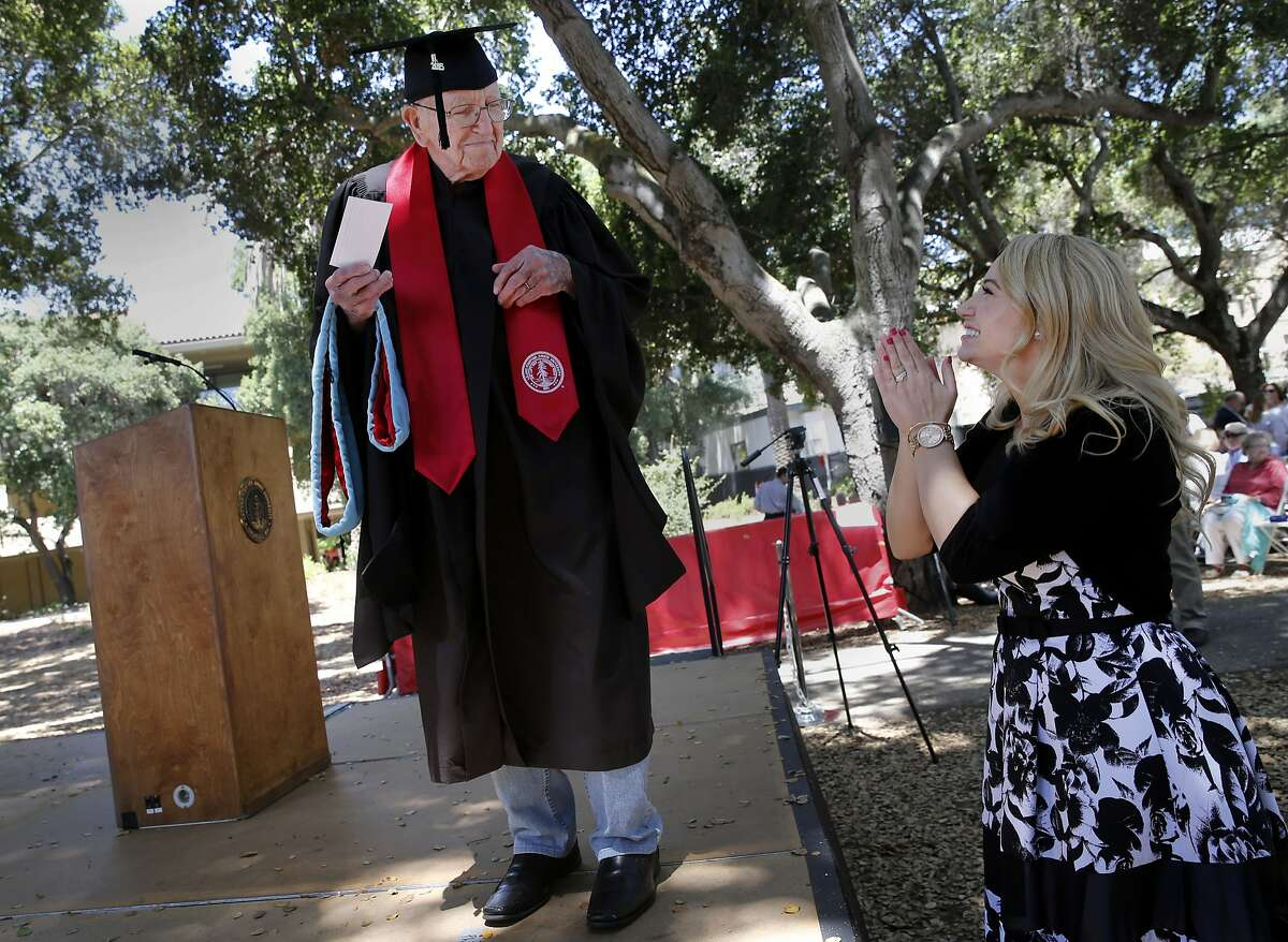 """Crystal Gould Sturgis applauds her grandfather Bonnie Gould as he rehearses his graduation on the Stanford campus. Bonnie """"Chuck"""" Gould, a 93 year old man, who earned his Education master's degree from Stanford University in 1954 finally picked up his degree at graduation ceremonies Sunday June 14, 2015."""