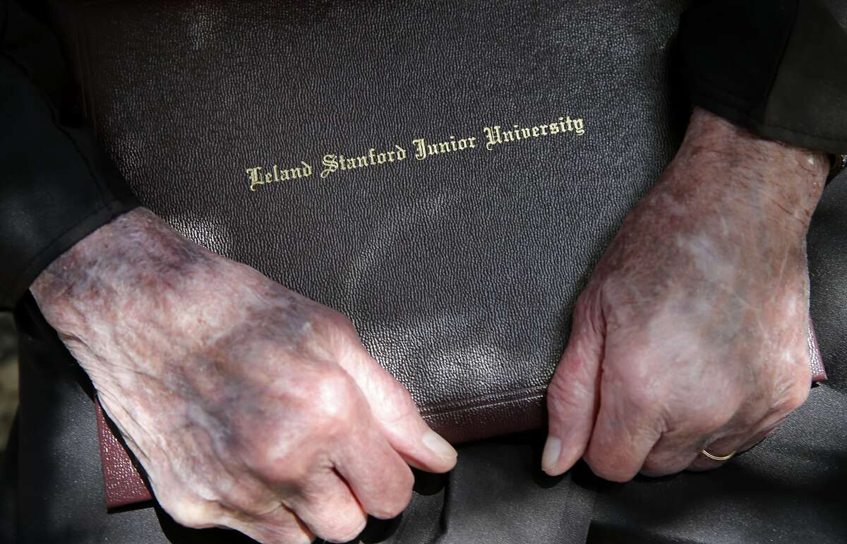 """Bonnie Gould holds his diploma case after the ceremony at Stanford University. Bonnie """"Chuck"""" Gould, a 93 year old man, who earned his Education master's degree from Stanford University in 1954 finally picked up his degree at graduation ceremonies Sunday June 14, 2015."""