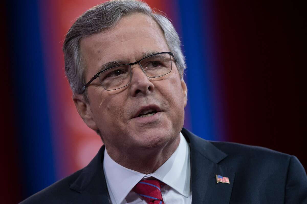 """(FILES) This February 27, 2015 file photo shows former Florida governor Jeb Bush as he speaks at the annual Conservative Political Action Conference (CPAC) at National Harbor, Maryland, outside Washington,DC. The campaign logo is ready, so is the big speech, and his message is taking shape: Jeb Bush is about to join the crowded Republican field running for president in 2016. Bush, 62, has run a de facto race for six months, raising money and increasing his travels, including a trip this week to Europe. On Sunday, his campaign released his logo. It reads """"Jeb!"""" in big red letters on a white background, with 2016 in smaller blue lettering underneath the name. """"I think the transition to a candidacy will allow me to be more direct about my advocacy of the leadership skills necessary for the next president to fix a few things,"""" Bush told CNN in an interview aired June 14, 2015, a day before his planned announcement in Miami. AFP PHOTO/NICHOLAS KAMMNICHOLAS KAMM/AFP/Getty Images"""